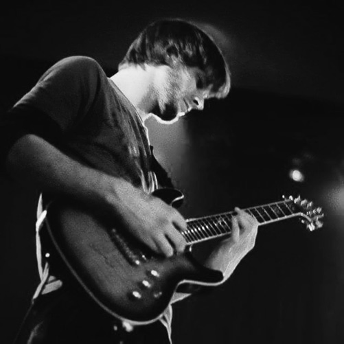 Photo of Ryan Sellick of Lead Salad playing guitar